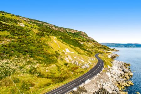 Northern Ireland, UK. Causeway Coastal Route a.k.a Antrim Coast Road. One of the most scenic coastal roads in Europe. Aerial view Zdjęcie Seryjne