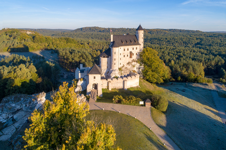 Medieval Castle in Bobolice, Poland, built in 14th century, renovated in 20th century. One of strongholds called Eagles Nests in Polish Jurassic Highland in Silesia. Aerial view in sunrise light Publikacyjne