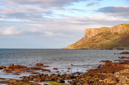 Famous Fair Head cliff on the Northern coast of County Antrim, Northern Ireland, UK. Sunset light Zdjęcie Seryjne