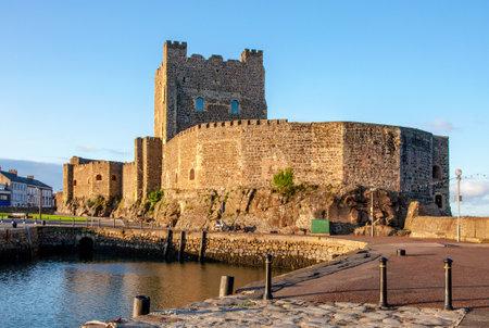 Medieval Norman Castle in Carrickfergus near Belfast, Northern Ireland, UK,  in sunset light
