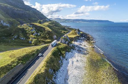 Causeway Costal Route with a car and coach, a.k.a. Antrim Coastal Road on eastern coast of Northern Ireland, UK. Zdjęcie Seryjne