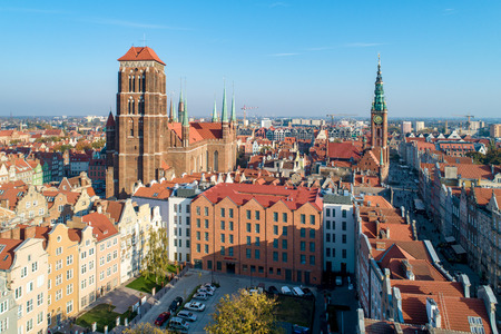 Gdansk, Poland. Old city with St Mary church, town hall tower, Dluga (Long) Street, and old historic houses.  Aerial view in sunset light