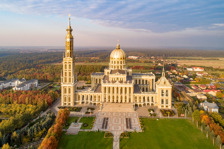 Sanctuary and Basilica of Our Lady of Licheń in small village Lichen. The biggest church in Poland, one of the largest in the World. Famous Catholic pilgrimage site. Aerial view in fall. Sunset light