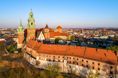 Historic Royal Wawel Cathedral and castle in Krakow, Poland. Aerial view in spring at sunset light. Old Jewish Kazimierz district in the background