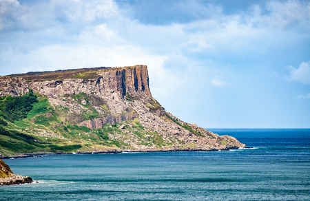Famous Fair Head cliff on the Northern coast of County Antrim, Northern Ireland, UK.