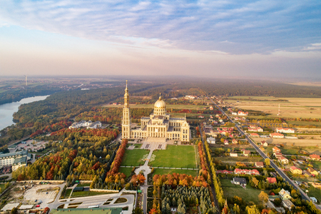 "Sanctuary and Basilica of Our Lady of LicheÅ"" in small village Lichen. The biggest church in Poland, one of the largest in the World. Famous Catholic pilgrimage site. Aerial view in fall. Sunset light Stok Fotoğraf"