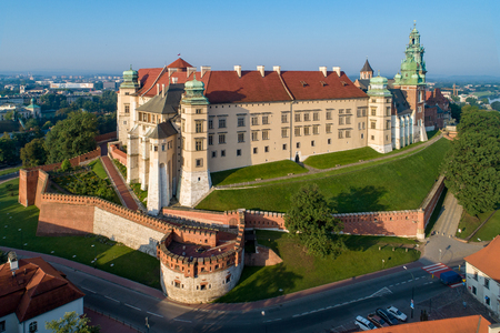 Historic royal Wawel castle and cathedral in Cracow, Poland.  Aerial view in sunrise light early in the morning in summer