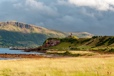 Western coast of County Antrim, Northern Ireland, UK, with the ruin of medieval Red Bay Castle, cliffs near Glenariff, Watrerfoot and Cushendall at coast road A2, a.k.a. Causeway Coastal Route Zdjęcie Seryjne