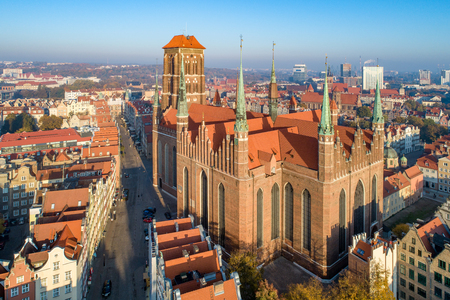 Medieval Gothic Saint Mary Cathedral and Gdansk old city in Poland. Aerial view in sunrise light. Early morning Zdjęcie Seryjne