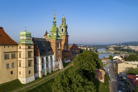 Krakow, Poland. Wawel Cathedral at historic royal castle and Vistula River with a bridge.  Aerial view in sunrise light early in the morning in summer Publikacyjne