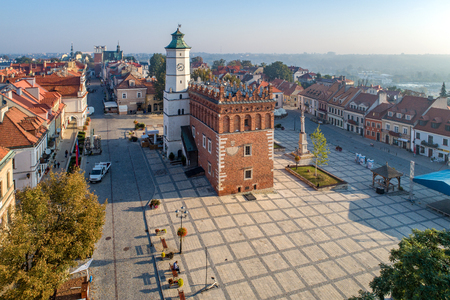 Sandomierz old city, Poland. Aerial view in sunrise light. Gothic city hall with clock tower and Renaissance attic and St Mary statue in the market Square (Rynek). One of the oldest towns in Poland. Zdjęcie Seryjne