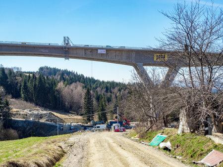 Skomielna Biala, Poland - March 27, 2019: New highway in national road no 7, E77, called zakopianka, under construction. The viaduct over  the village Skomielna-Biala.
