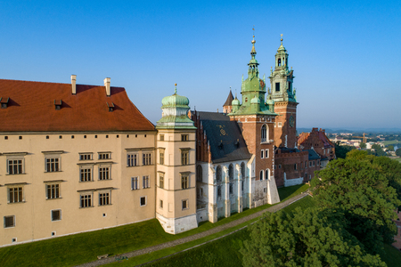 Wawel Cathedral at Historic royal castle in Cracow, Poland.  Aerial view in sunrise light early in the morning in summer