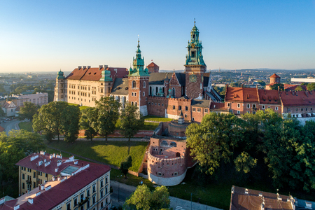 Historic royal Wawel castle and cathedral in Cracow, Poland. Aerial view in sunrise light early in the morning