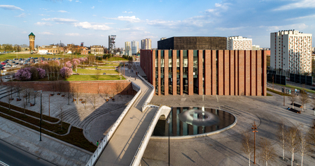 Poland, Katowice city center panorama with concert hall of National Symphonic Orchestra of Polish Radio (NOSPR),  old coal mine, presently Silesian Museum, fountain, bridge, park and blocks of flats