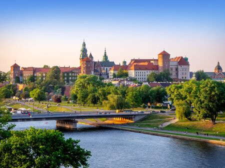 Krakow, Poland. Wawel castle and cathedral, Vistula river, Podwawelski bridge, trees and promenades in summer. Aerial view Editorial