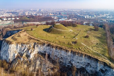 Krakus Mound -Kopiec Krakusa commemorating a legendary founder of Krakow. The origin of the mound, probably early medieval kurgan, is not known. Old quarry in front. City panorama in the background