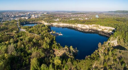Krakow, Poland. Zakrzowek lake with steep cliffs in place of former flooded limestone quarry in Twardowski Rocks. Popular recreational place. Aerial panorama at sunrise