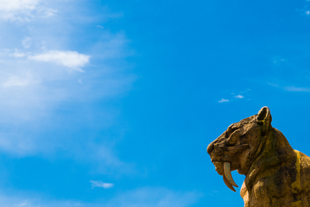 Sabertooth tiger statue in the lower right corner and an amazing blue sky in La Plata, Buenos Aires. Stock Photo