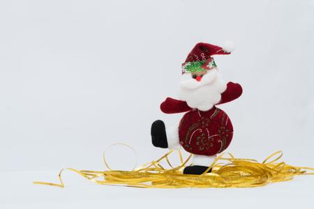Adorable red Santa Claus with gold ground and white background. Stock Photo