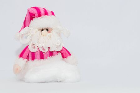 christmas grounds: Adorable pink Santa Claus with white background. Stock Photo