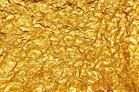 光沢のある黄色葉ゴールド箔テクスチャ背景 写真素材