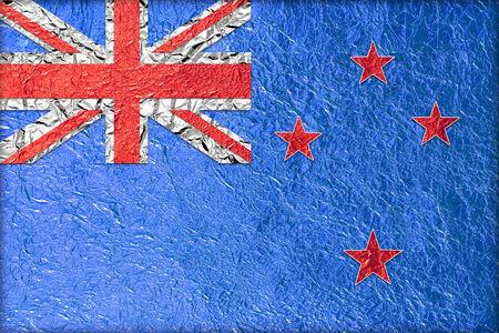 New Zealand Flag with a Shiny  leaf  Bronze Shiny  leaf   foil texture background photo