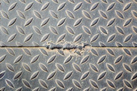blotched: The damage metal diamond plate Stock Photo