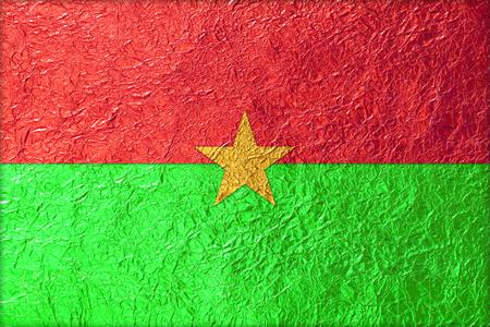 Burkina Faso Flag with a Shiny  leaf  Bronze Shiny  leaf   foil texture background photo