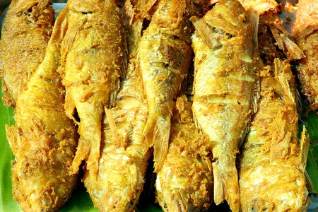 kerala culture: Fried fish on banana leaf Stock Photo