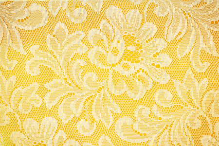 Peach lace sits on a yellow background photo