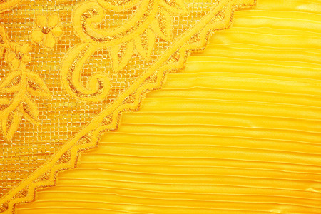 Gold peach lace sits on a gold background photo