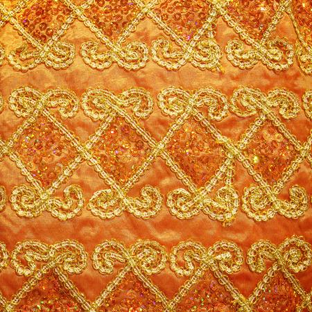 tissu or: guipure or, broderie sur la texture de tissu