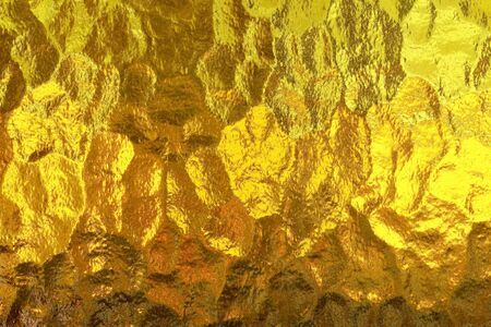 shiny gold: Shiny yellow gold glass abstract texture background Stock Photo