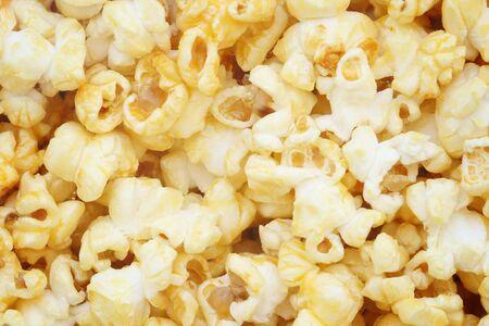 Popcorn, snacks een achtergrond Stockfoto