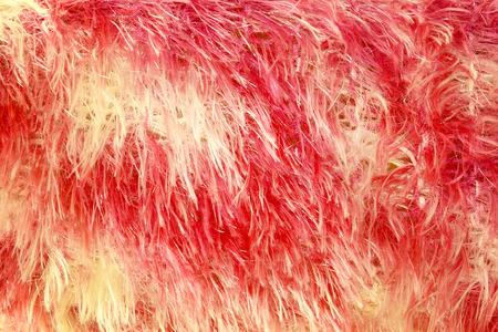 sheepskin: red dyed sheepskin rug as a background