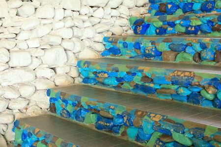 inconsistent: blue stone stairs and white wall