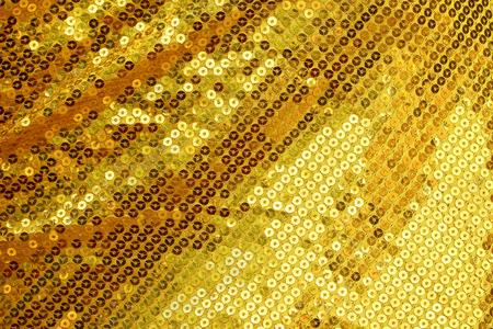 ゴールドに輝いてきらびやかな背景