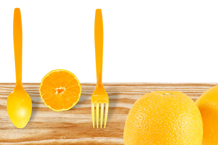 high angles: fresh orange with spoon on wood floor and white background. Stock Photo