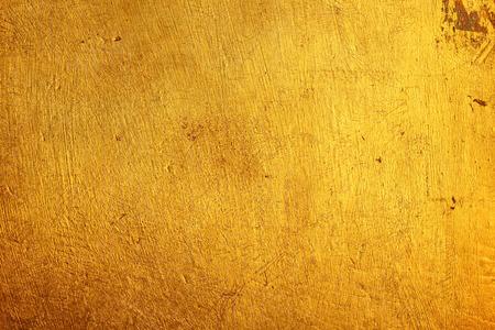 暗いゴールドの大まかなテクスチャ背景 写真素材