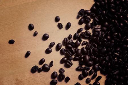coffeetree: Coffee beans on wood background dark tone