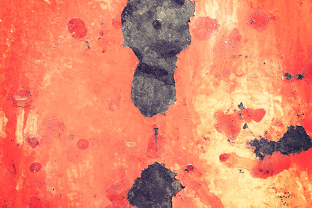 flaking: Rusty metal surface with old peeled paint for use as a texture or background