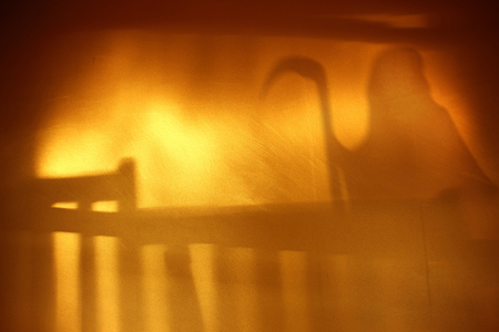 ghost: Ghost shadow blur standing in stairs on golden wall