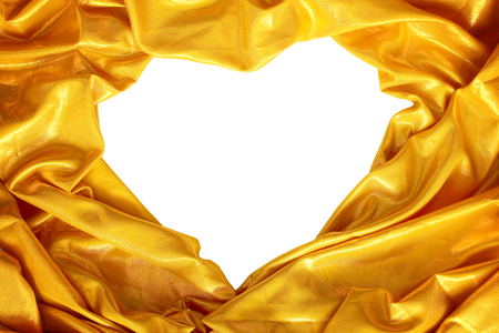 Gold silk fabric with heart-shaped white background Stockfoto
