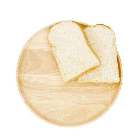breadboard: Slice of brown bread on wooden breadboard isolated white background