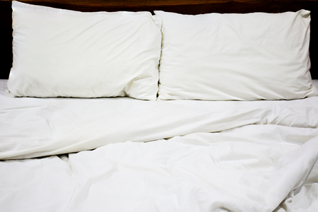 bedlinen: Messy white bed and pillow, in the morning