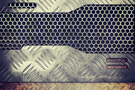 grille: old rusty metal plate over comb grid or grille background