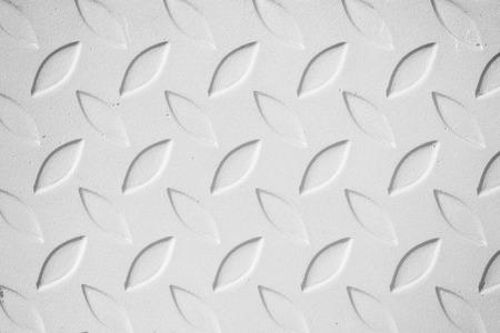 diamond plate: white metal diamond plate pattern background.