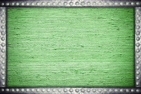 rivets: Old green fabric background with metal rivets frame