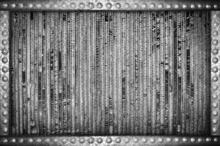 rivets: damaged radiator background with metal rivets frame